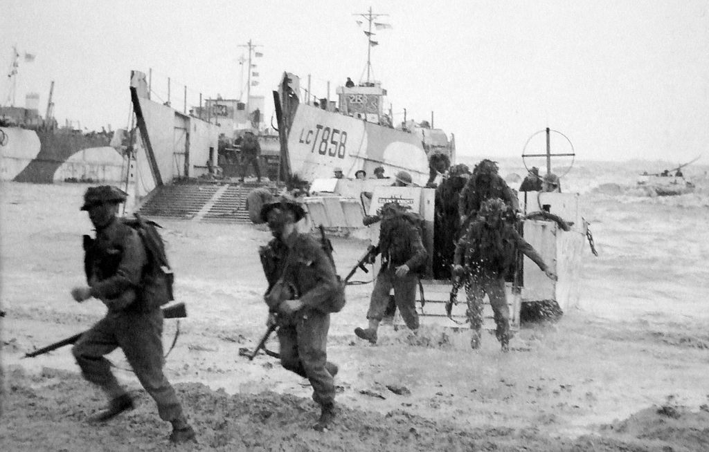 archival photo of wwii soldiers storming gold beach normandy